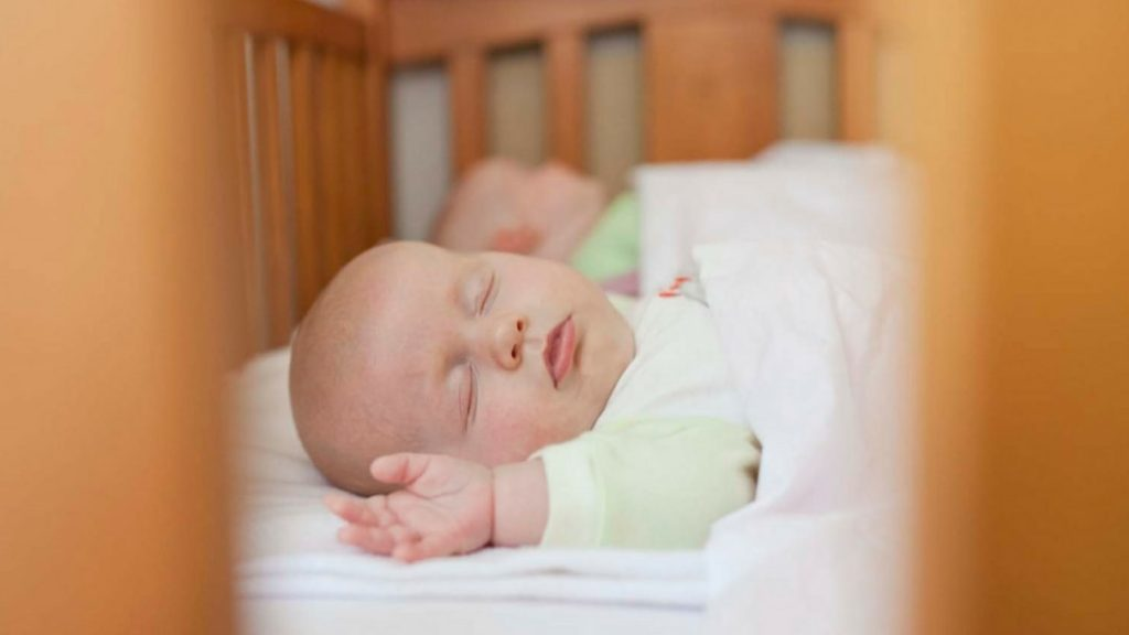 Baby Twins Sleeping in Cot - Twins & More