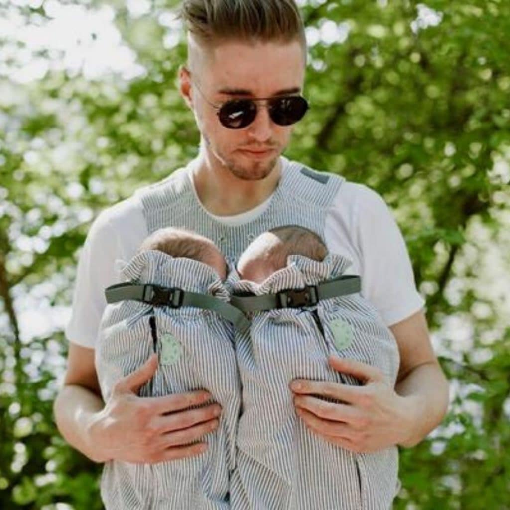 Twin Dad Carrying baby twins in Weego Twin Carrier